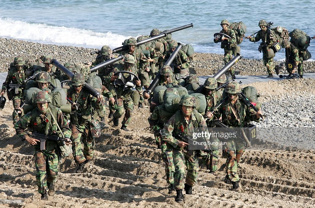 South Korean marines take part in landing exercises in preparation for possible threats from North Korea at Pohang beach on October 27, 2006 in Pohang, South Korea. South Korea will be enforcing U.N. sanctions after North Korea tested its nuclear capabilites in an underground blast on October 9.