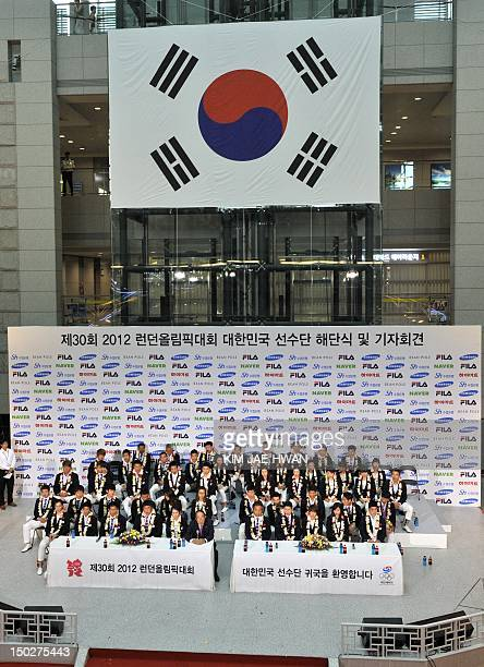 South Korean medalists attend a ceremony upon their return at Incheon airport west of Seoul on August 14 2012 South Korea's main athletic delegation...