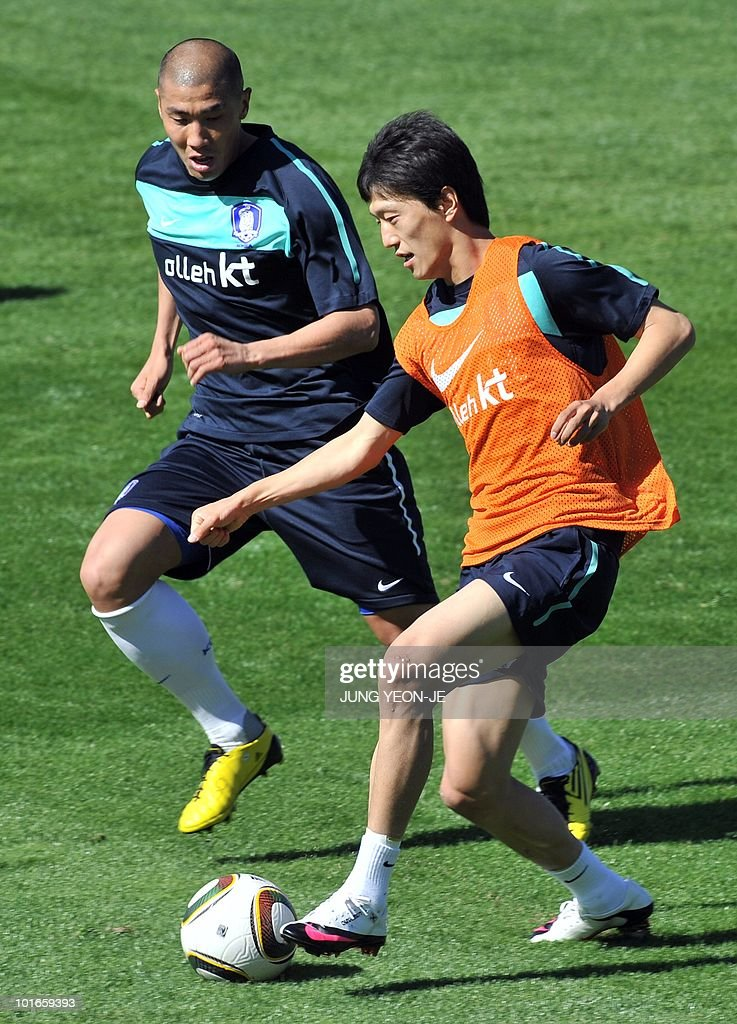 South Korean midfielder Lee Chung-Yong (R) vies for the ball with defender Cha Du-Ri during a training session at the Olympia Park Stadium in Rustenburg on June 6, 2010 ahead of the start of the 2010 World Cup football tournament.