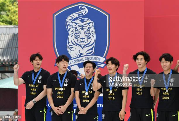 South Korean midfielder Lee Kangin the 2019 FIFA U20 World Cup Golden Ball winner and his teammates pose during a welcoming ceremony for the South...