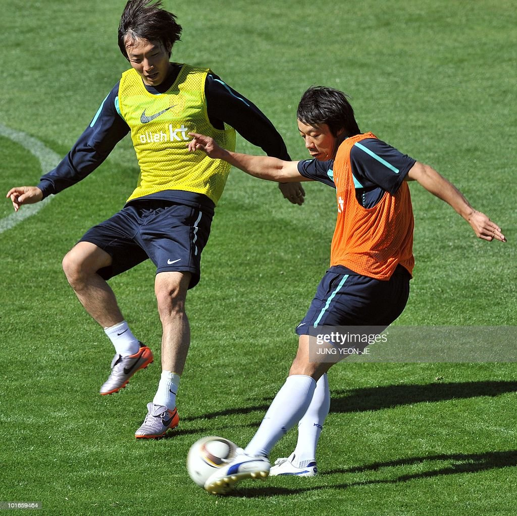 South Korean midfielder Yeom Ki-Hun (R) kicks the ball as defender Cho Yong-Hyung (L) tries to block him during a training session at the Olympia Park Stadium in Rustenburg on June 6, 2010 ahead of the start of the 2010 World Cup football tournament.
