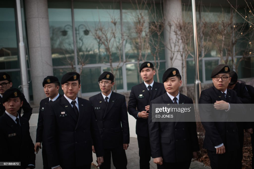 South Korean military cadets gather in the truce village of Panmunjom, within the Demilitarized Zone (DMZ) dividing the two Koreas on February 21, 2018. / AFP PHOTO / Ed JONES