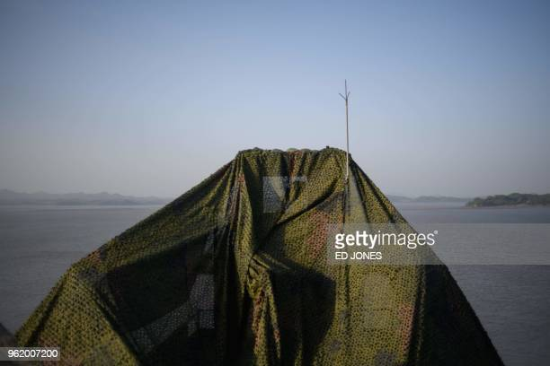 South Korean military guard post stands before the shore line of North Korea and the Demilitarized Zone separating the two countries on Ganghwa...