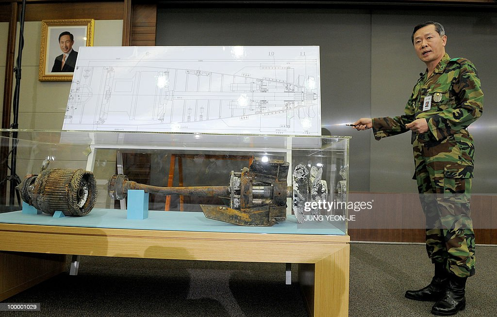 A South Korean military officer shows torpedo parts salvaged from the Yellow Sea during a press conference at the Defense Ministry in Seoul on May 20, 2010. A torpedo fired by a North Korean submarine sank The South Korean warship Cheonan with the loss of 46 lives, investigators said.