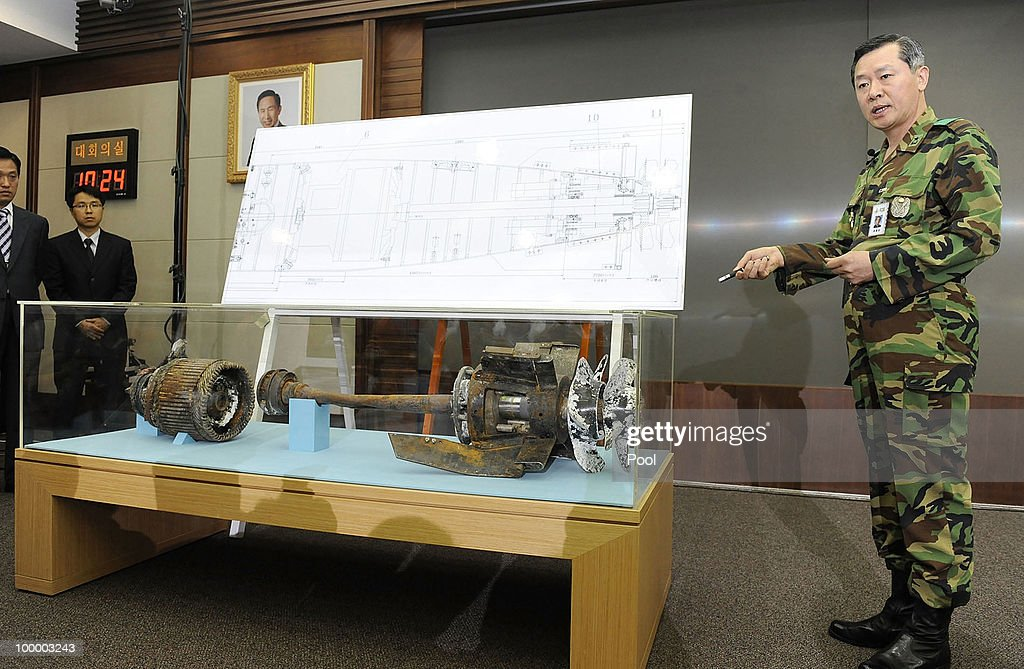 A South Korean military officer shows torpedo parts salvaged from the Yellow Sea during a press conference at the Defense Ministry on May 20, 2010 in Seoul, South Korea. The multinational investigation team concluded that North Korea's torpedo sank the South Korean warship on March 26, killing 46 sailors.