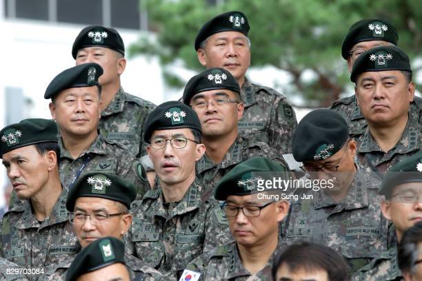 South Korean military officers participate in a changeofcommand ceremony at the Yonsan US army base on August 11 2017 in Seoul South Korea North...
