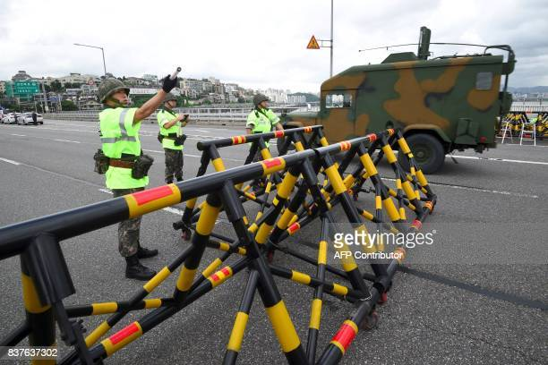 A South Korean military vehicle passes barricades on Hannam bridge during a regular defence drill against possible artillery attacks by North Korea...