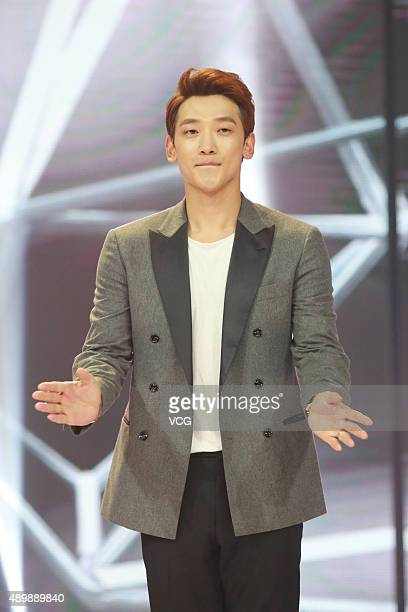 """South Korean model and actor Rain dances on the stage during the Chinese talk show broadcast """"Day Day Up"""" recording on September 24, 2015 in..."""
