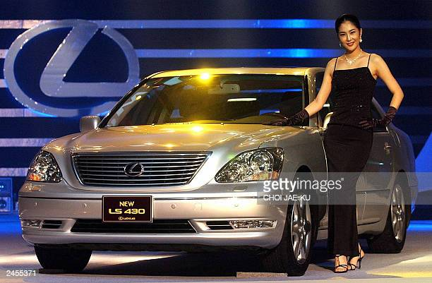 A South Korean model poses near a new Lexus LS430 made by Toyota from Japan during a new car launch at a hotel in Seoul 02 September 2003 The New...