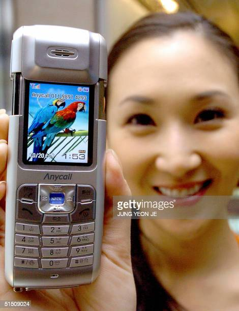 South Korean model shows Samsung Electronics' new digital camera mobile phone 'SCHS250' during its unveiling ceremony at the main office in Seoul 20...