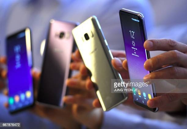 South Korean models show Samsung Galaxy S8 smartphones during a showcase to mark the domestic launch of Samsung Electronics' latest flagship...