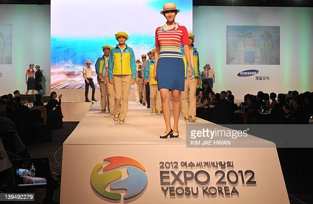 South Korean models show the uniforms of volunters and staff for this year's expo in the southern port of Yeosu during a fashion show in Seoul on...