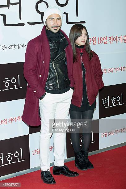 South Korean music video director Coolk Arron Kim and Lee SaeYoung attend The Attorney VIP screening at COEX Mega Box on December 11 2013 in Seoul...