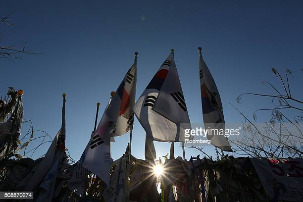 South Korean national flags fly above a barbedwire fence at the Imjingak pavilion near the demilitarized zone in Paju South Korea on Sunday Feb 7...