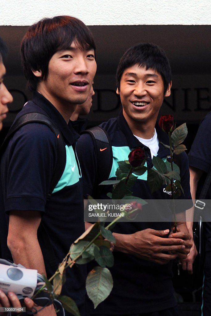 South Korean national football team player Cho Yong Hyung (L), Lee Keun Ho (R) smile during the their team arrival for their training camp in the Tyrolian village of Neustift im Stubaital in Austria on May 25, 2010, prior to the FIFA World cup 2010 in South Africa.