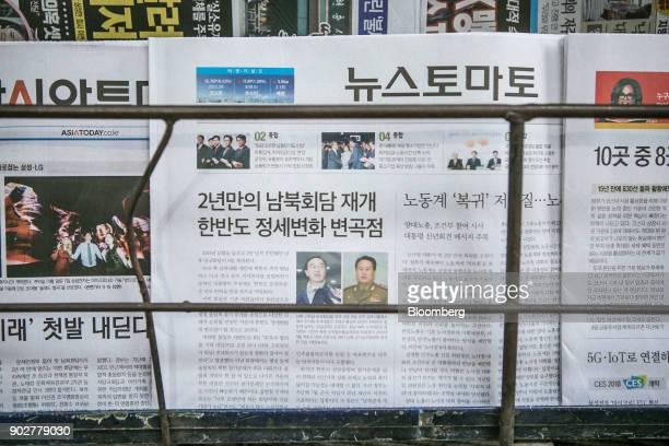 A South Korean newspaper featuring photographs of Cho Myounggyon South Korea's unification minister left and Ri Son Gwon chairman of North Koreas...