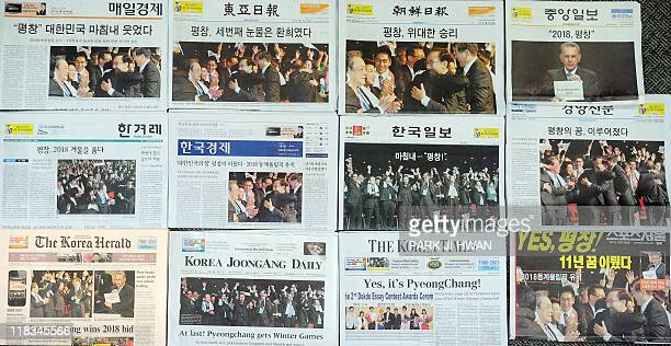 South Korean newspaper front pages show coverage of the Pyeongchang 2018 Winter Olympics in Seoul on July 7 2011 For the South Korean candidate it...