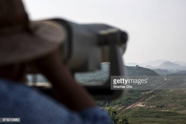 South Korean observes the border between South and North Korea through a binocular telescope at Goseong Unification Observatory on June 7 2018 in...