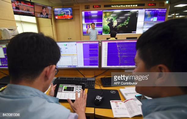 South Korean officials monitor screens showing a graph of seismic waves originating from North Korea at the Korea Meteorological Administration in...