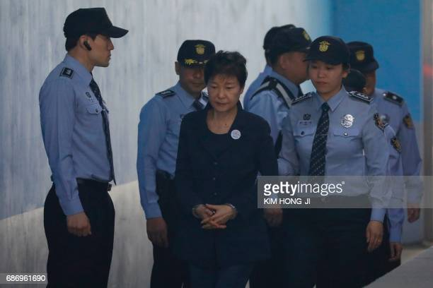 South Korean ousted leader Park Geun-hye arrives at a court in Seoul on May 23, 2017. Park Geun-Hye was due in court on May 23 to face trial over the...