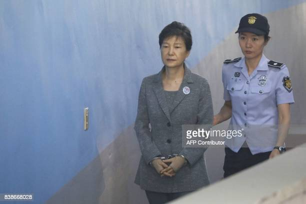 South Korean ousted leader Park Geun-hye arrives at a court in Seoul on August 25, 2017. The heir to the Samsung business empire, including the...