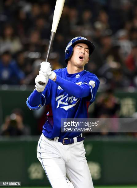 South Korean outfielder Koo JaWook reacts after strikeout at the fourth inning during the Asia Professional Baseball Championships final match...