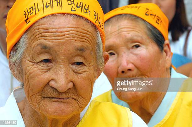South Korean Park OkRyun and others forced into sexual slavery for Japanese troops during World War II listen during an antiJapanese protest by about...