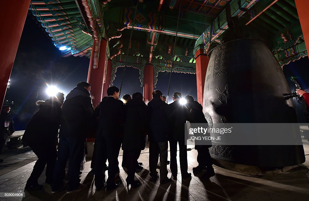 south korean participants prepare to strike a huge traditional bell during a countdown event to celebrate the new year at imjingak peace park in the border