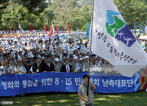 South Korean people enter anniversary of the National Liberation Day in Pyongyang 15 August 2003 Civic representatives of North and South Korea began...