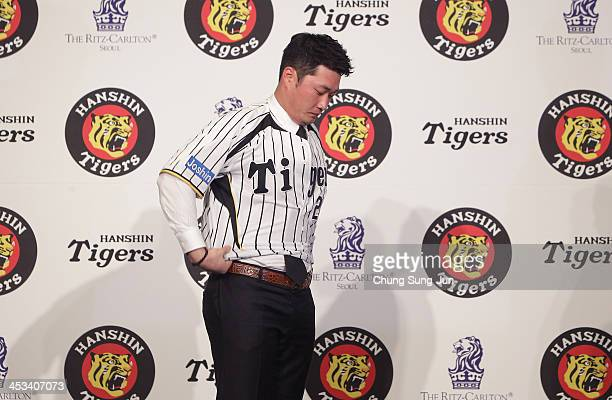 South Korean Pitcher Oh SeungHwan wear Hanshin Tigers uniform during the press conference at Ritz Carlton hotel on December 4 2013 in Seoul South...