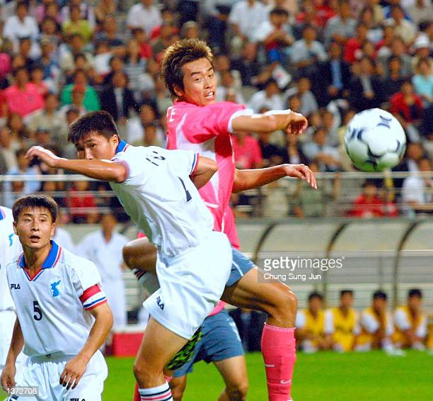 South Korean player fights for the ball with North Korean players at the World Cup Stadium September 7 2002 in Seoul during a match intended to...