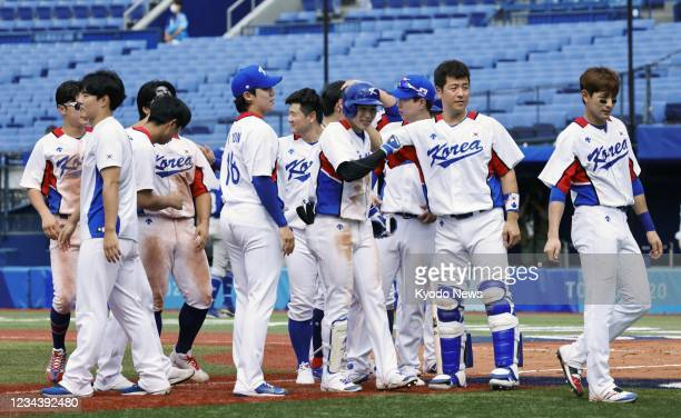 South Korean players celebrate after defeating Israel in the second round of the Tokyo Olympic baseball tournament on Aug. 2 at Yokohama baseball...