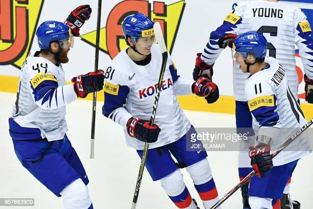 South Korean players celebrate after scoring their first goal during the group B match Denmark vs Korea of the 2018 IIHF Ice Hockey World...