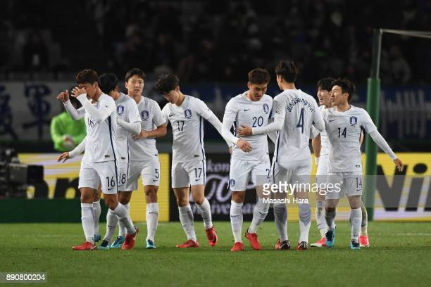 South Korean players celebrate their first goal scored by Ri Yong Chol of North Korea during the EAFF E1 Men's Football Championship between North...