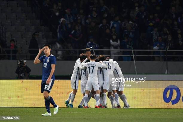 South Korean players celebrate their fourth goal scored by Yeom Kihun to make 41 during the EAFF E1 Men's Football Championship between Japan and...
