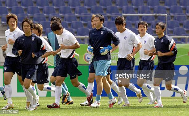 South Korean players jog during a training session at the World Cup Stadium in Hanover, 22 June 2006. South Korea will face Switzerland on 23 June in...