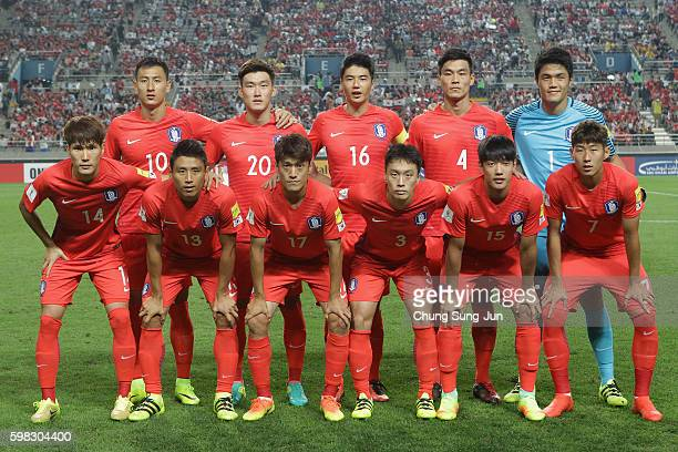 South Korean players line up for the team photos prior to the 2018 FIFA World Cup Qualifier Final Round Group A match between South Korea and China...