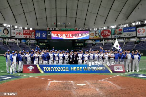 South Korean players pose for photographs as they celebrate qualified for the Tokyo 2020 Olympic Games after their victory in the WBSC Premier 12...