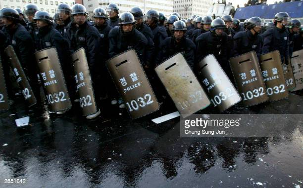 South Korean police block farmers from entering the national assembly during clashes on January 8 2004 in Seoul South Korea Thousands of farmers have...