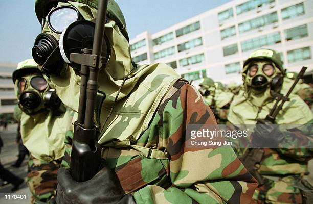 South Korean police officers run to biochemical terror exercises October 19, 2001 at the headquarters of the National Police Agency in Seoul. The...