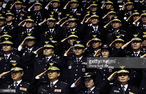 South Korean police officers salute at the official launch ceremony of the 2012 Seoul Nuclear Security Summit on February 15, 2012 in Seoul, South...