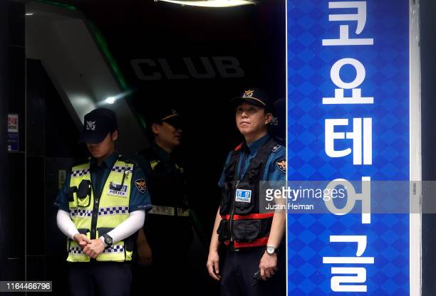 South Korean police stand inside the entrance way to the nightclub Coyote Ugly on July 27 2019 in Gwangju South Korea Two people were killed with at...