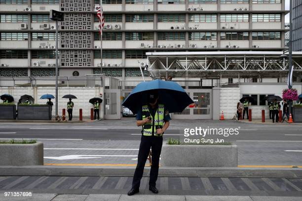 South Korean policeman stands in front of the US embassy on June 11 2018 in Seoul South Korea The historic meeting between US President Donald Trump...