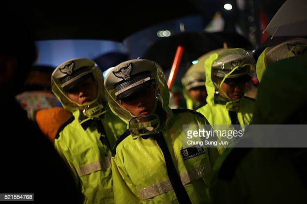 South Korean policemen stand guard during the second anniversary of the Sewol disaster on April 16 2016 in Seoul South Korea On April 16 the Sewol...