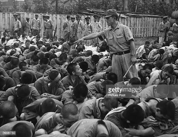 South Korean political prisoners at Pusan, Korea. Original Publication: Picture Post - 5086 - We Follow the Road To Hell - pub. 1950