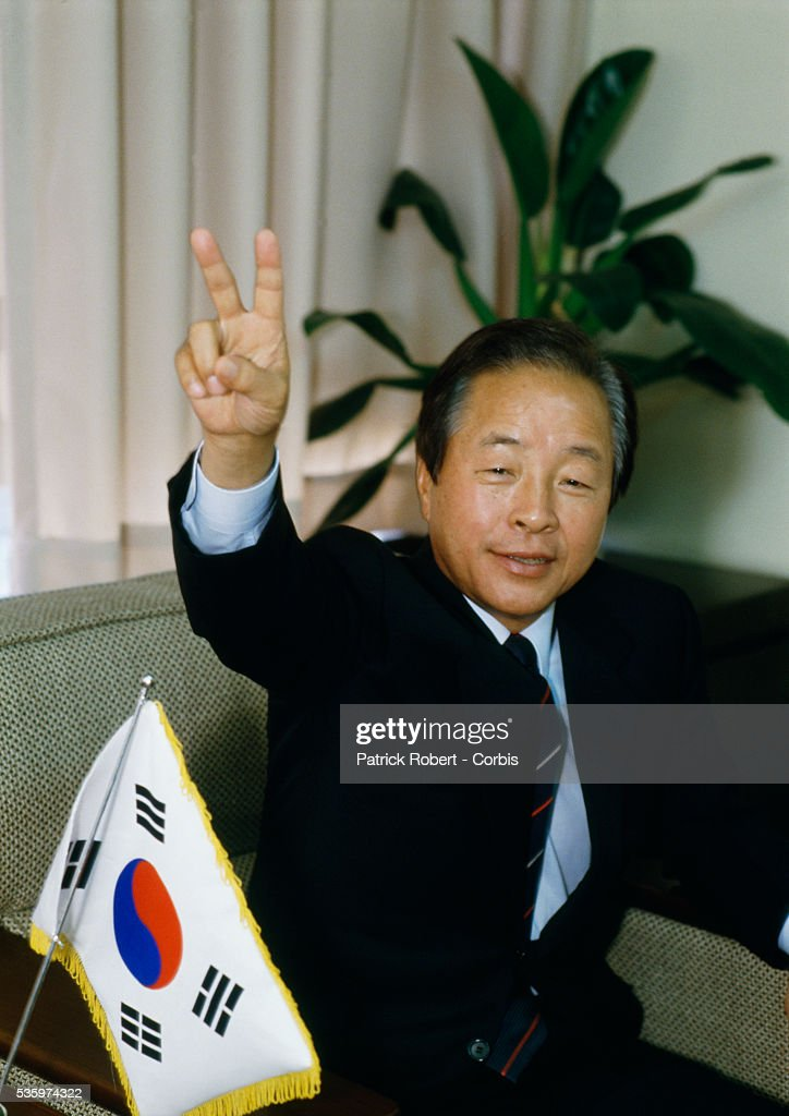 South Korean politician Kim Young Sam holds up two fingers in Seoul. Kim ran for president in South Korea's first popular presidential election in 1987. He was defeated in the 1987 elections, but won the presidency in 1992 and became the first nonmilitary president in over 30 years.