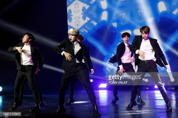 South Korean pop group BTS performs during a Korean cultural event as part of South Korean president official visit to France on October 14 2018 in...