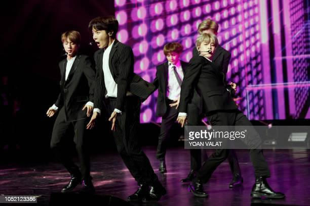 TOPSHOT South Korean pop group BTS performs during a Korean cultural event as part of South Korean president official visit to France on October 14...