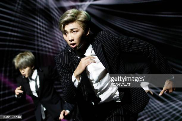 South Korean pop group BTS performs during a Korean cultural event as part of South Korean President official visit in France on October 14 2018 in...