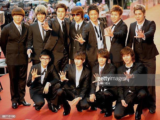 South Korean pop group 'Super Junior' pose on the red carpet of the 20th Golden Melody Awards in Taipei on June 27 2009 Performers from Taiwan Hong...